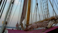 Ropes and rolled big clothes on the sail mast of the ship GH4 4K video