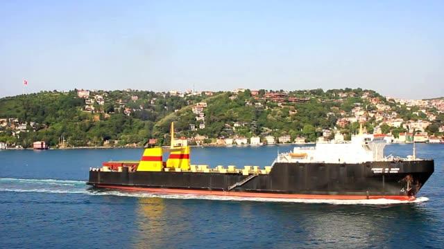 Ro-ro cargo ship sailing close to the shore video