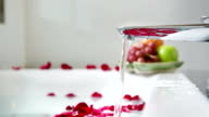 Rose petals on water at bathtub in Valentine day video