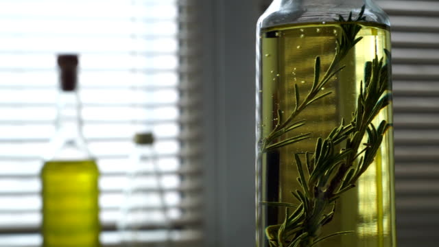 Rosemary herb falls olive oil bottle. Herbs and spices. Extra virgin olive oil video