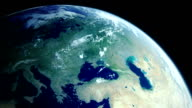Rotatin earth showing Europe from space with moving clouds video