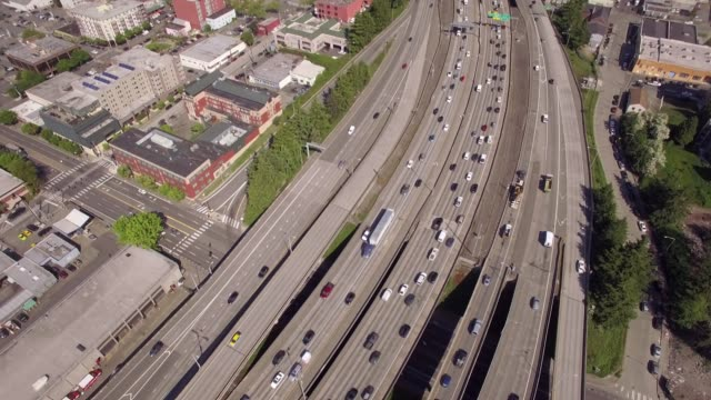 Rotating Aerial from Cars on Interstate Freeway to Skyline Buildings in Downtown Seattle, Washington video