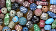 Rotating ancient  decorated ceramic indian beads from Varanasi, video background video