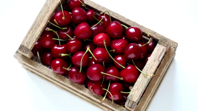 Rotating box of red cherries video