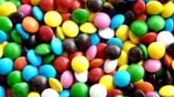rotating chocolate, colorful candy, lentilky, dragee video