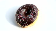 rotating chocolate donut with colorful toppings video