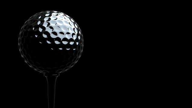Rotating golf ball on tee in macro  , HD , seamless LOOP video