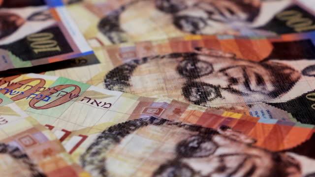 Rotating israeli money bills of one hundred shekel video