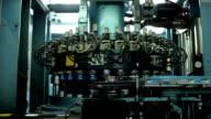 Rotating machine. Conveyor. Production Of Plastic bottle  Caps. video