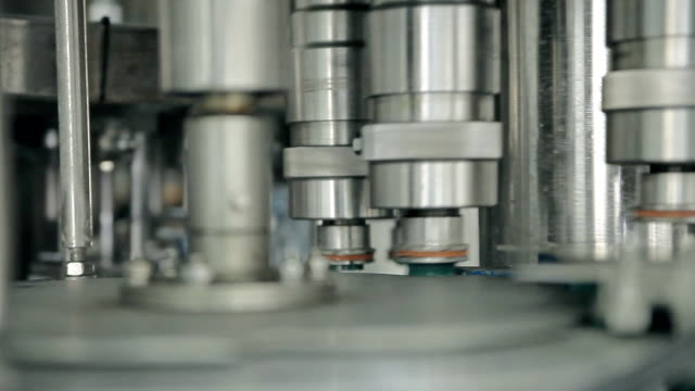 Rotating machines are moving bottles and pouring water video