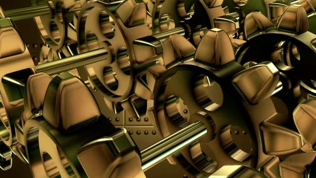 Rotating Metal gears in golden color video