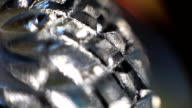 Rotating mirror glittering crystal glass surface close up video