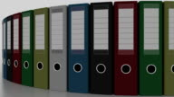 Rotating multicolored office binders. FullHD seamless loop able animation video