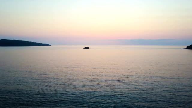 Rotating ocean sunset video