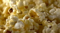 Rotating paper box of popcorn. FullHD macro clip video