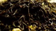 Rotating pile of jasmine green tea, macro video video