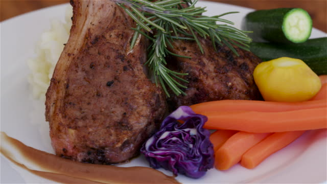 Rotating plate of lamp chops and vegetables video
