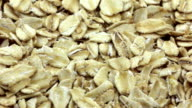 Rotating rolled oats flakes closeup video