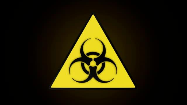 Rotating triangular biohazard sign. video
