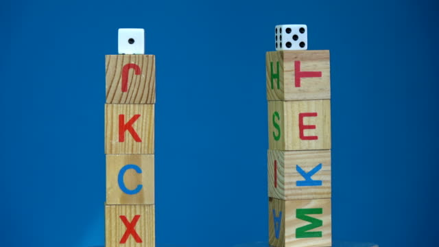Rotating two alphabetic cube stacks with word Cash and Risk video