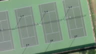 Rotating video of tennis courts from straight above video