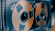 Rotation golden reel of vintage audio cassette in different color correction video