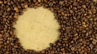 Rotation of the coffee beans lying on sackcloth video