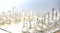 rotation: transparent chess on a glass table video