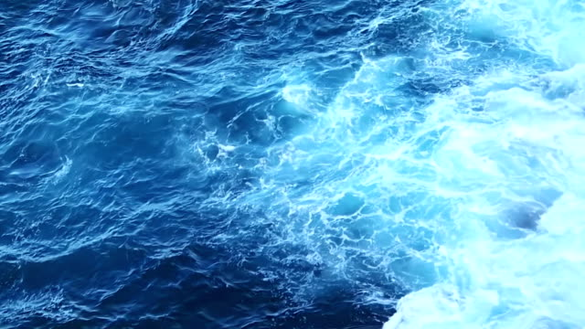 Rough waves of blue ocean hit and splash on rocks video