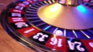 Roulette Wheel in a casino - 16 red wins video