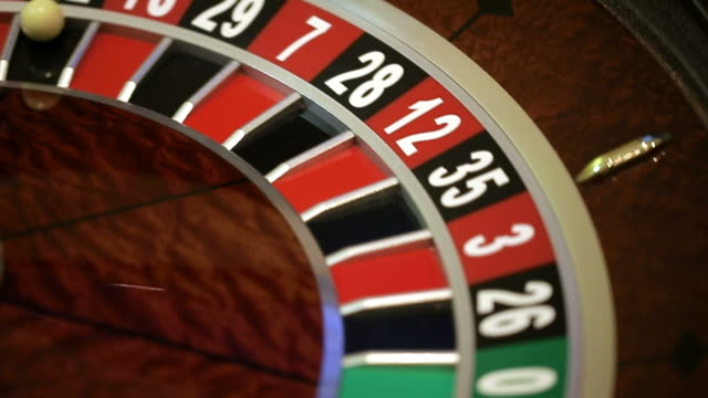 Roulette wheel running and stops with white ball video