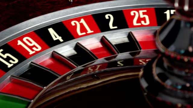 Roulette wheel starts running and stops with white ball video