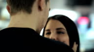 Round view of lovely couple talking in airport video