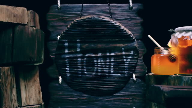 Round wood sign and honey video