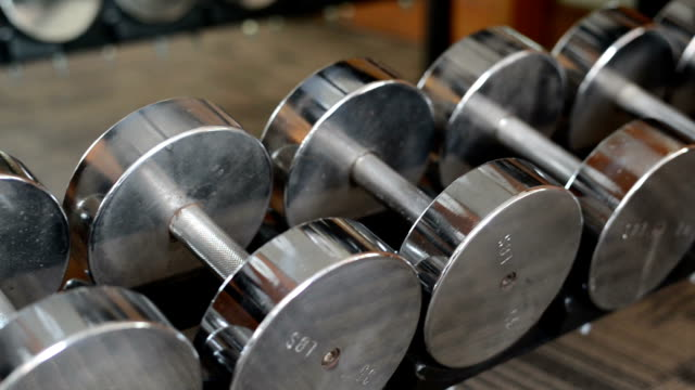 Row of dumbbells in gym video