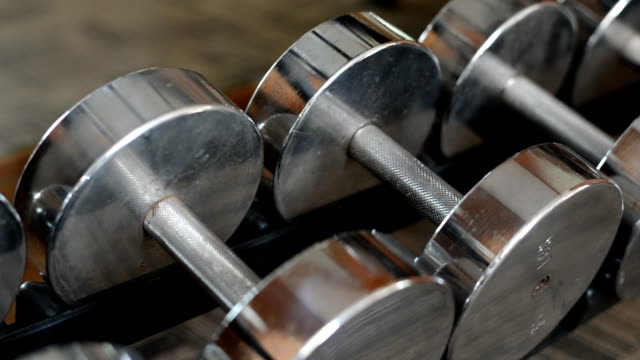 Row of dumbbells in sports club video