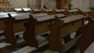Row of empty church benches. video