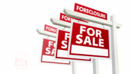 Row of Foreclosure Real Estate Signs Lining Up video