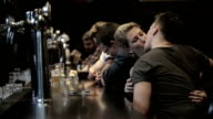 Row of people drinking at a bar video