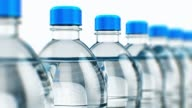 Row of plastic drink water bottles video