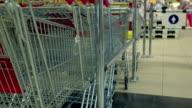 Row of shopping carts at supermarket entrance video