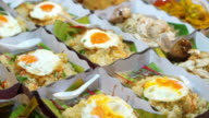 Row of Thai ready made meal in paper box to buy at local market video