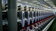 Row of Yarn Machines reeling in factory video
