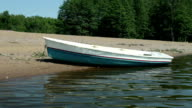 Rowingboat moored at shore video