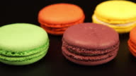 TRACKING: A rows of a colorful macaroons is on the black table video