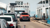 Rows of cars get off from a ferry in Koh Chang video
