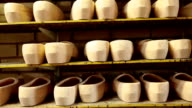 Rows of clogs on a shelf video