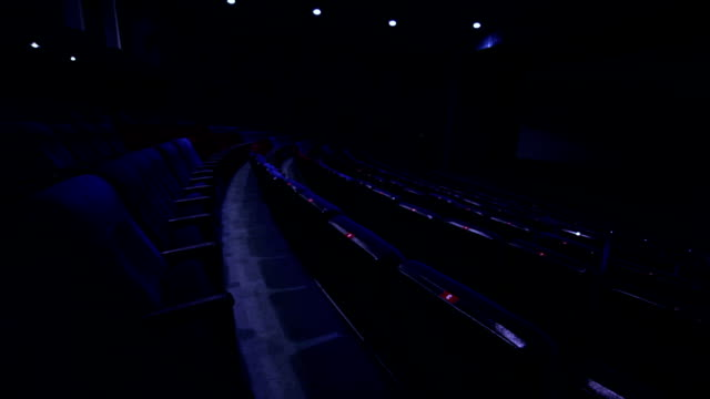 Rows of seats in empty blue cinema hall video