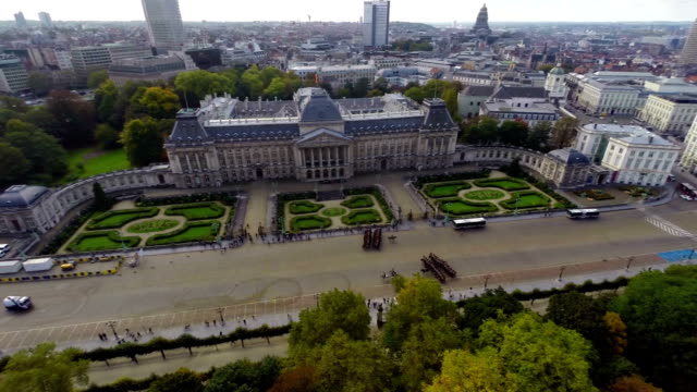 Royal Palace cavalry on parade marching Brussels city aerial. Beautiful aerial shot above Europe, culture and landscapes, camera pan dolly in the air. Drone flying above European land. Traveling sightseeing, tourist views of Belgium. video
