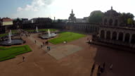 Royal Palace in Dresden aerial shot, Zwinger German court place. Beautiful aerial shot above Europe, culture and landscapes, camera pan dolly in the air. Drone flying above European land. Traveling sightseeing, tourist views of Germany. video